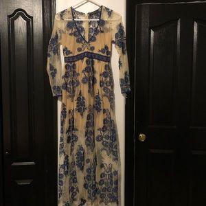 Vintage dress covered in navy blue laced design
